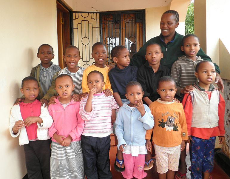Our twelve children with the new matron Maria Tambo